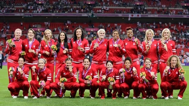 Canada's women's soccer team poses with their bronze medals at the London 2012 Olympic Games.