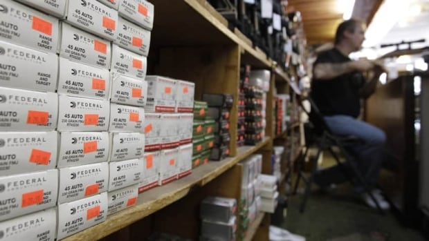 Boxes of ammunition line the shelves of a gun shop in Tinley Park, Illinois.