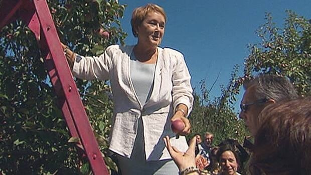 PQ Leader Pauline Marois picks apples at an orchard in Iberville, near Montreal.