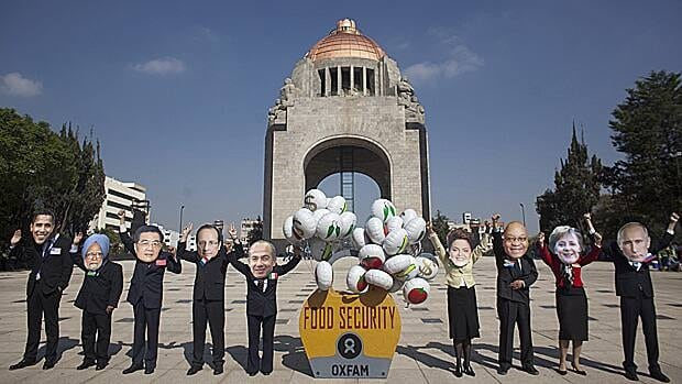 Activists wear masks of world leaders as they protest at the Revolution monument in Mexico City, June 14. Mexico will host the G20 summit starting June 15 in Los Cabos.