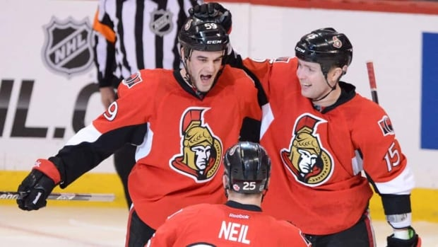 Dave Dziurzynski, left, was recalled by the Senators on Feb. 15 and made his NHL debut the following evening at Toronto.