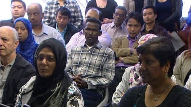 A group of new Canadians attended a meeting in Regina earlier this year. Almost all of the people moving to Saskatchewan in recent months are immigrants, Statistics Canada says.