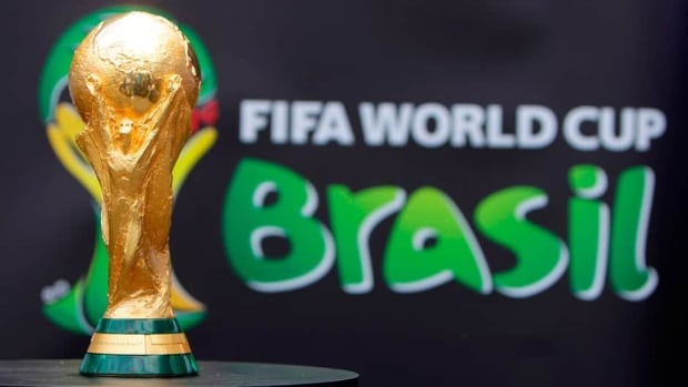 The 2014 FIFA World Cup Brazil trophy is displayed at an event at Copacabana beach in Rio de Janeiro, November 21, 2010.