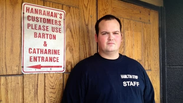 The club hasn't been Hanrahan's since the fall of 2000, but an old sign still sends patrons east. Hamilton Strip bouncer Jordan Connor likes the little touch of history.