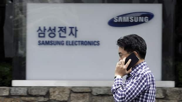 A man walks by Samsung Electronics Co.'s headquarters in Seoul. The company is facing allegations that it is mistreating workers and illegally using child labour at its factories in China.