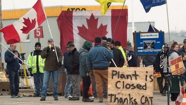 CAW workers picket outside at the Electro-Motive plant in London, Ont., on Friday. American-based heavy equipment maker Caterpillar Inc. announced Friday it was closing the plant, a month after it locked out about 450 workers.