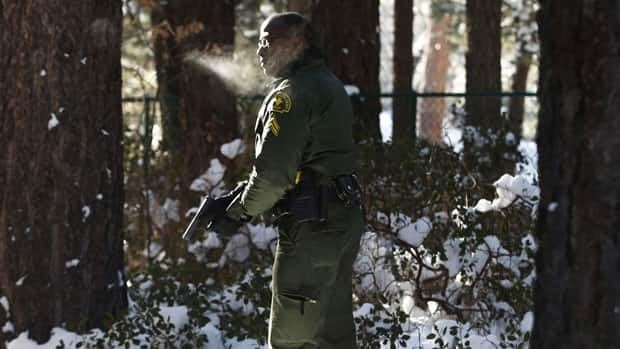 The hunt for former Los Angeles police officer Christopher Dorner suspected in three killings entered a fourth day in snow-covered mountains Sunday, a day after the police chief ordered a review of the disciplinary case that led to the fugitive's firing.