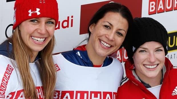 Canada's Sarah Reid, right poses with race winner Shelley Rudman, centre, and silver medallist Noelle Pikus-Pace.