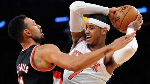 New York Knicks' Carmelo Anthony, right, is pressured by Portland Trail Blazers' Jared Jeffries on Tuesday night. Blazers couldn't stop Carmelo, who scored 45, but they did win the game.
