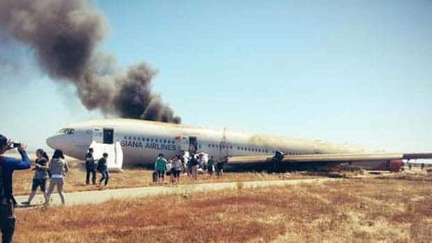 Two 16-year-old girls died after an Asiana flight from Seoul crash landed in San Francisco. Amazingly, 307 passengers and crew escaped. Passenger David Eun took this photo of people carrying their luggage off the plane.