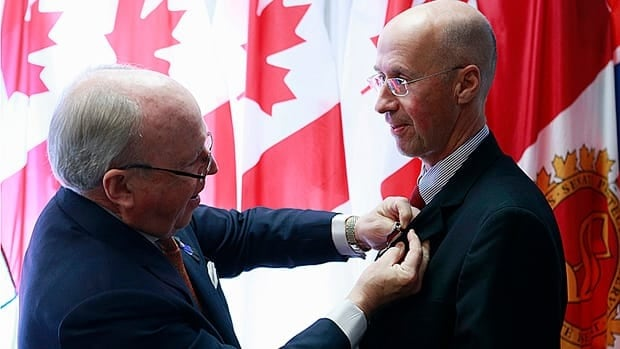 Parliamentary Budget Officer Kevin Page was presented with a Diamond Jubilee medal from Senator Colin Kenny in November. His single term as Canada's budget watchdog is set to end in March.