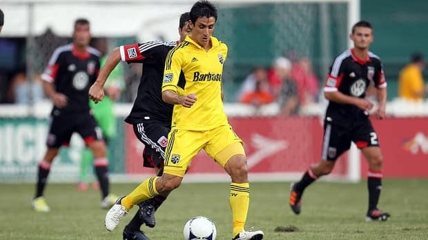 Milovan Mirosevic of the Columbus Crew controls the ball against Branko Boskovic #8 of D.C. United.