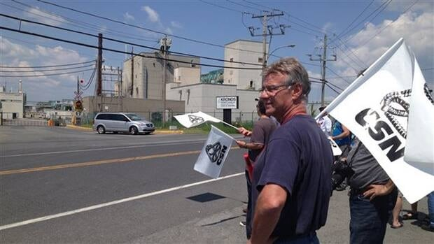 A 64-year-old Kronos employee is in hospital after being struck by a vehicle at worker protest.
