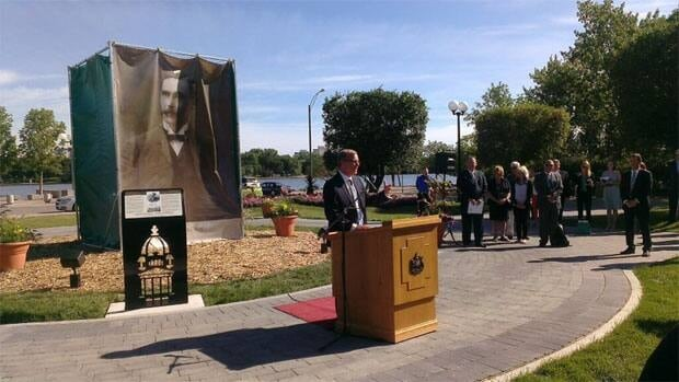 Premier Brad Wall ready to unvail a life-size statue of Walter Scott in front of the legistative building.