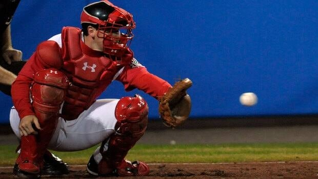 "Canadian manager Ernie Whitt says catcher Chris Robinson, seen here at the 2009 world baseball championships, ""is a solid defensive catcher and he does a lot of things positively with his bat."""
