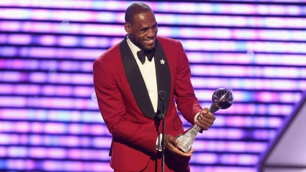 LeBron James accepts his award for Best Male Athlete onstage at the 2013 ESPY Awards in Los Angeles, Calif., on Wednesday.