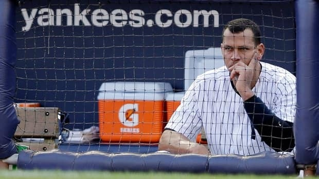 New York Yankees' Alex Rodriguez sits in the dugout after striking out in the second inning of Game 2 of the ALCS against the Detroit Tigers on Sunday.
