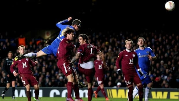 Fernando Torres of Chelsea rises above the Rubin Kazan defence to score his team's third goal with a header in their Europa League quarter-final match Thursday.