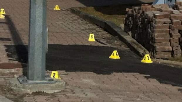 Police evidence markers at the scene of the incident.
