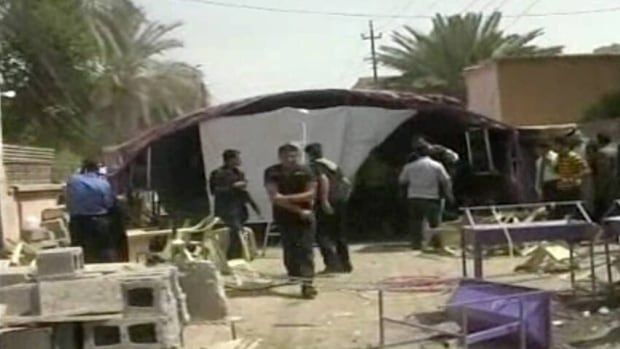 This image from AP video shows the aftermath of a suicide attack in Baqouba, Iraq. A suicide bomber blew himself up Saturday at a lunch hosted by a Sunni candidate in Iraq's upcoming regional elections, killing 20 people, officials said.