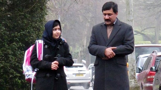 Malala with her father Ziauddin, as she attends her first day of school in Birmingham UK on March 19, just weeks after being released from hospital.