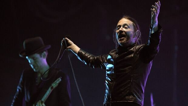 Ed O'Brien (left) and Thom Yorke (right) of Radiohead are seen performing in Indio, Calif., on April 14, 2012. The band has announced it will postpone a portion of its European tour after one of its crew members was killed in a stage collapse in Toronto.