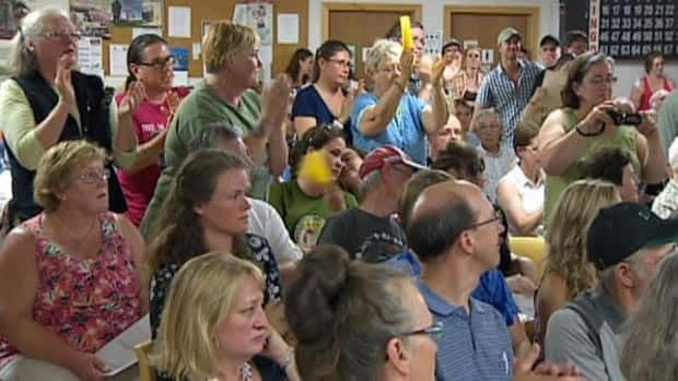 Opponents to shale gas exporation applaud a speaker during a public meeting in Norton on Wednesday.