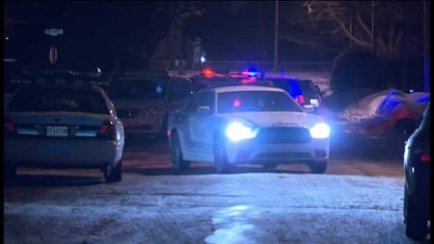 Montreal police investigate the shooting death of a 16-year-old in Dorval on Jan. 24, 2013.