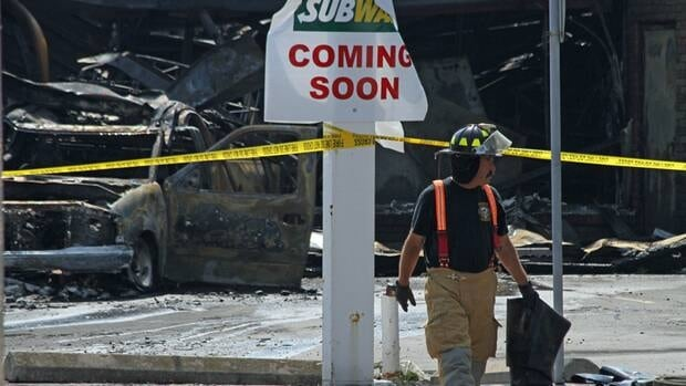 Hamilton police have opened a homicide investigation after discovering the remains of a man in a burned out building.