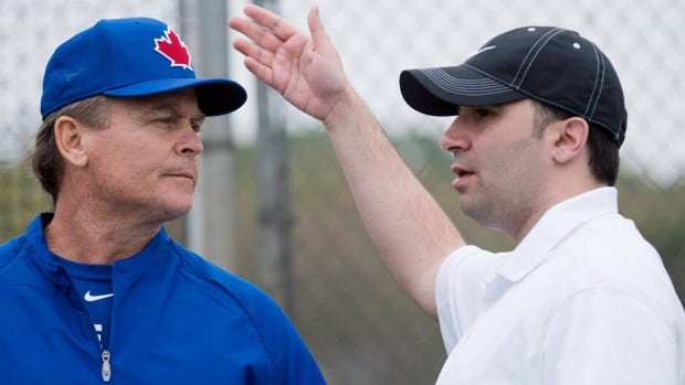 Toronto Blue Jays general manager Alex Anthopoulos, right, hired manager John Gibbons before the season.