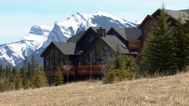 Some residents in Canmore are not happy with a plan by PricewaterhouseCoopers Canada to resume building the Three Sisters Mountain Village.