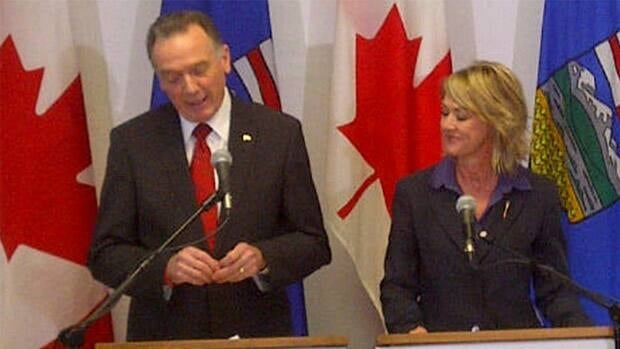 Federal Environment Minister Peter Kent and Alberta Environment Minister Diana McQueen announce an oilsands monitoring plan Friday in Edmonton.