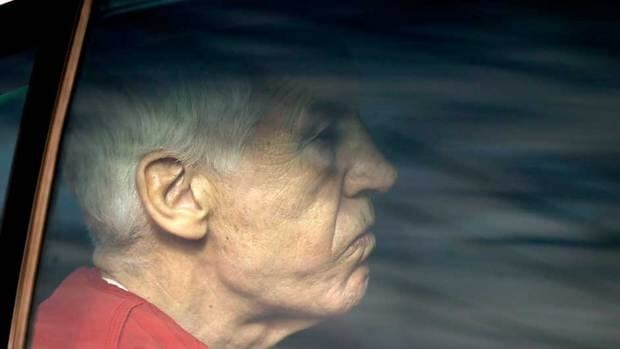 Former Penn State University assistant football coach Jerry Sandusky is driven from the Centre County Courthouse after being sentenced in Bellefonte, Pa., on Oct. 9.