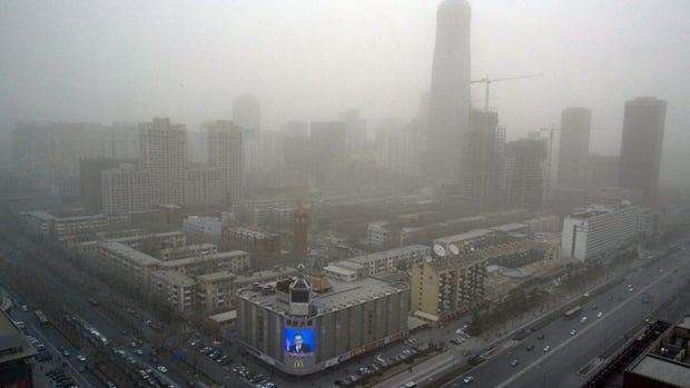 Chinese Premier Wen Jiabao's press conference is telecast live on a mall screen on March 18, 2008, a day of severe air pollution in Beijing before the city hosted the Summer Olympics.