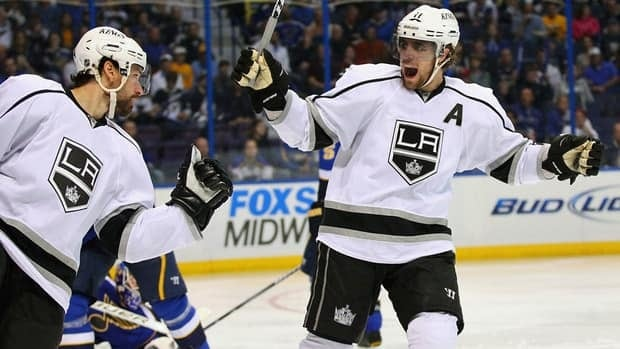 Los Angeles Kings' Anze Kopitar, right, celebrates after teammate Justin Williams scores against the St. Louis Blues on Monday.