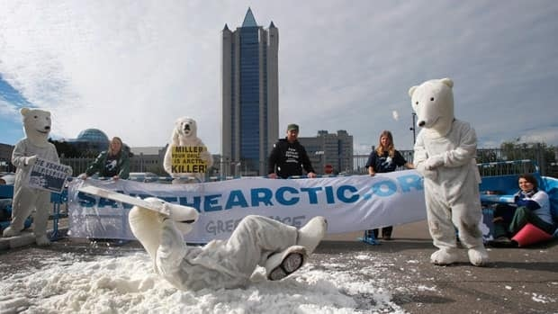 Greenpeace activists dressed as polar bears protest against drilling in the Arctic outside Gazprom's headquarters in Moscow, Russia, Wednesday, Sept. 5, 2012.