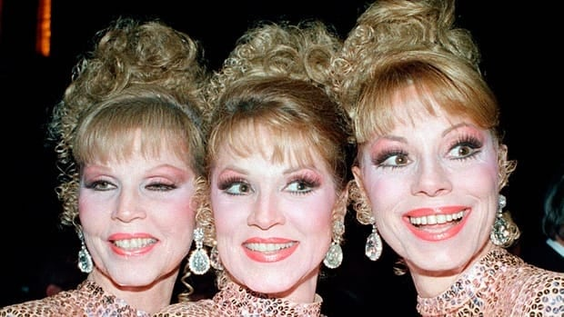 The McGuire Sisters, from left, Christine, Phyllis and Dorothy, pose outside Radio City Music Hall in New York. Dorothy McGuire has died at age 84. Her two sisters are still alive.