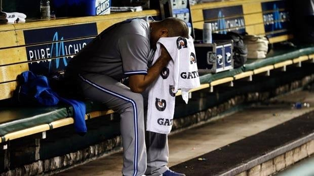 Toronto Blue Jays pitcher Ricky Romero sits on the bench after being relieved against the Detroit Tigers in the sixth inning on Tuesday.
