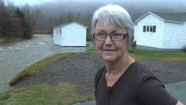 Rita Moulton stands in front of her shed, which was flooded on Saturday. CBC