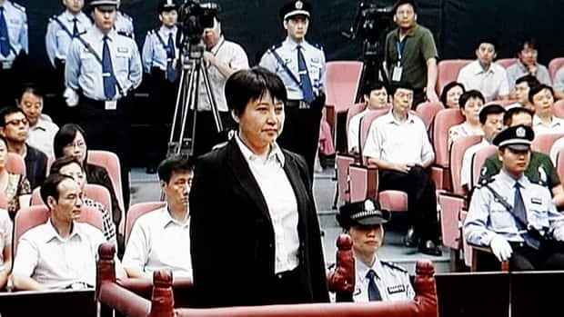 Gu Kailai, the wife of disgraced politician Bo Xilai, standing in the witness box during her brief trial on murder charges on Thursday.