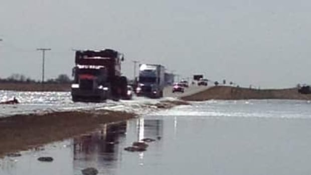 Semi-trailers make their way through heavy runoff east of Radisson, Sask.