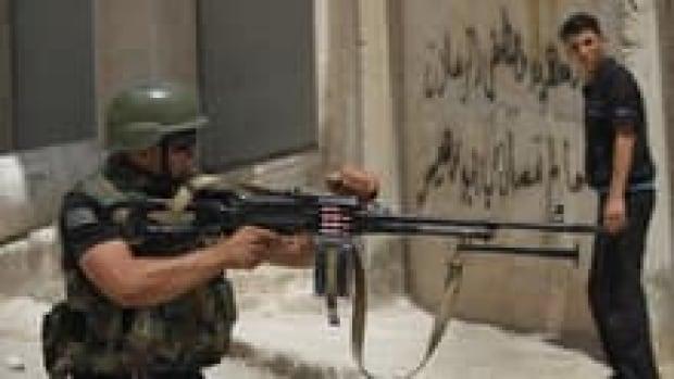 hi-852-syria-clashes-028122-3col