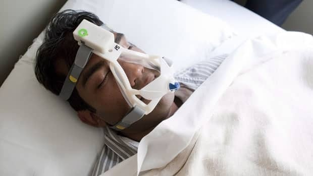 Scientific associate Tilak Dutta wears a device, designed to allow at-home diagnosis of sleep apnea, at the sleep research lab at Toronto Rehab-UHN on May 3. Sleep apnea has been largely associated with men, but a new Swedish study suggests half of women also have the disorder.