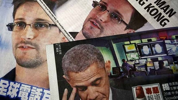 Photos of Edward Snowden, a former contractor at the U.S. National Security Agency, and U.S. President Barack Obama are printed on the front pages of local English and Chinese newspapers in Hong Kong today. Snowden, who leaked details of top-secret U.S. surveillance programs, dropped out of sight in Hong Kong on Monday.
