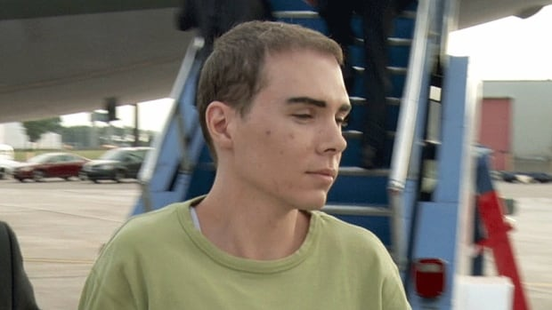 Luka Rocco Magnotta is taken by police from a Canadian military plane to a waiting van in Quebec. Police were hot on Luka Rocco Magnotta's trail just weeks before he allegedly killed and dismembered university student Jun Lin, according to a former landlord.