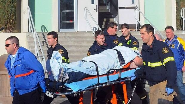 Paramedics transport a student wounded during a shooting Thursday at a high school in Taft, Calif. Authorities said a 16-year-old male student student was taken into custody.