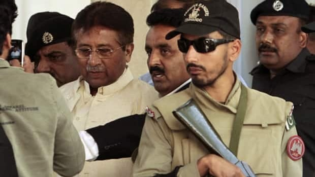 Pakistan's former president Pervez Musharraf (centre) leaves after his appearance before the High Court in Rawalpindi on April 17.