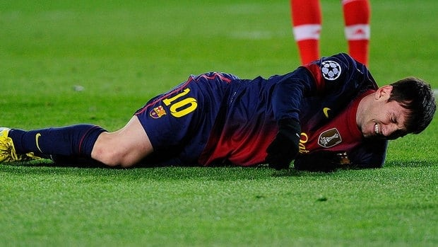 Lionel Messi of FC Barcelona reacts on the pitch after hurting his left knee in Champions League action Wednesday. The Barcelona forward might only miss one match.