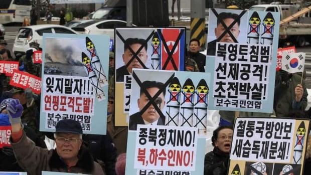 South Korean protesters shout slogans during a rally denouncing North Korea's rocket launch, which could happen as soon as Monday.