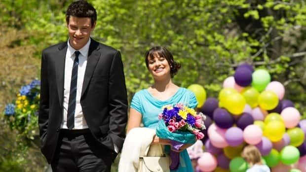Actors Lea Michele and Cory Monteith film a scene for the television show Glee on location in Central Park in New York, on April 26, 2011. Fox says the new season of the show will be delayed by the death of Monteith.